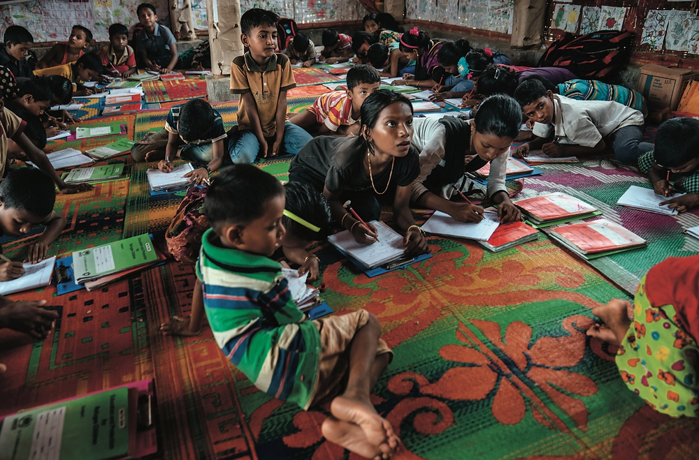 A Burmese language class being taught by a former student of Futhu's in the Rohingya refugee camps in Bangladesh.CreditAdam Dean for The New York Times