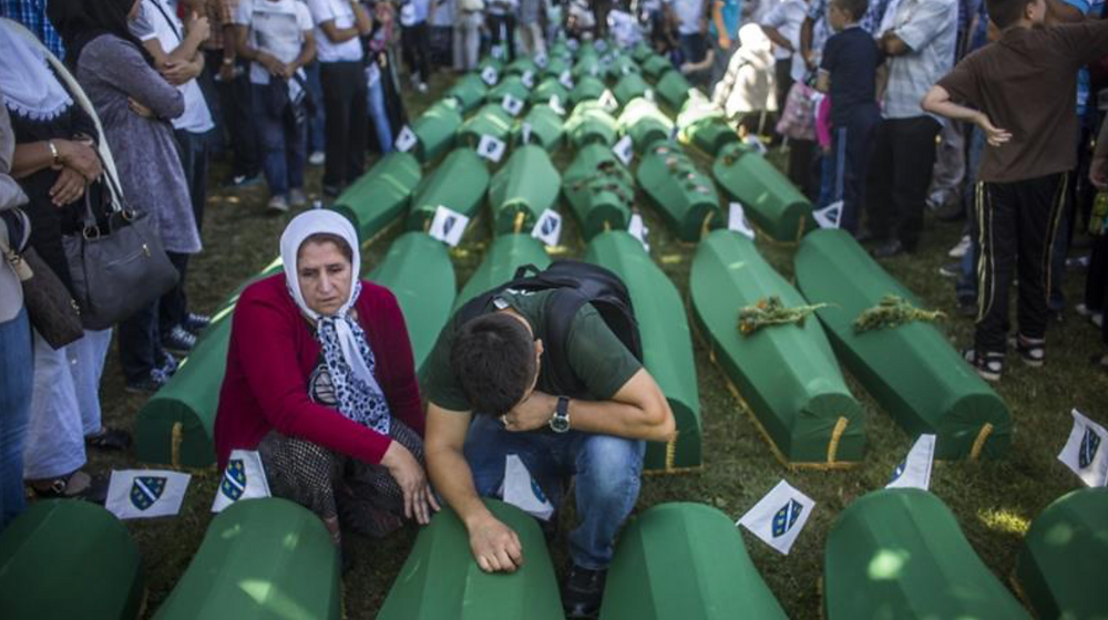 Family members mourn at the mass funeral for newly-identified victims of the 1995 Srebrenica genocide [File: Matej Divizna/Getty Images]