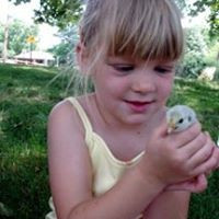 A preschool Kate with a new chick