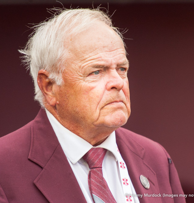 Legendary coach Ron Polk prepares to deliver the first pitch during the grand opening ceremony at the newly renovated Dudy Noble Field.