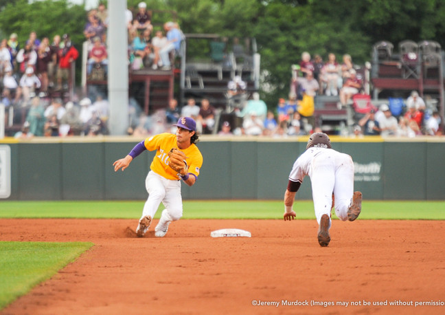 Brent Rooker attempts to steal second base against LSU.