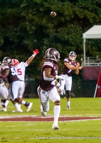 Nick Fitzgerald delivers a pass to wide receiver Deddrick Thomas.