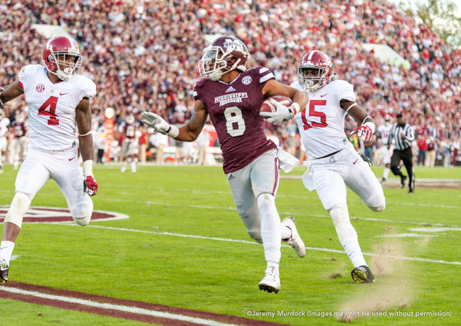 Wide receiver Fred Ross attempts to break away from the Alabama defense.
