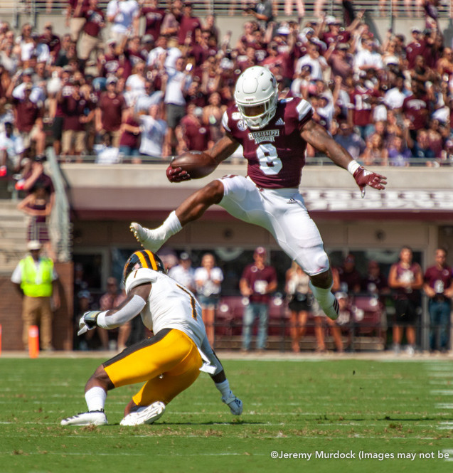 Kylin Hill hurdles a University of Southern Mississippi defender.
