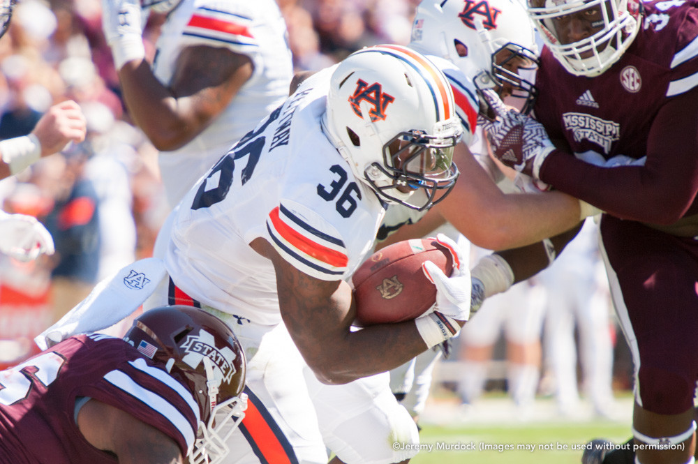 Auburn running back Kamryn Pettway powers through the Bulldog defense.