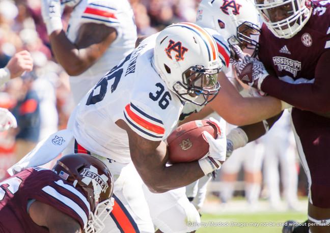 Auburn running back Kamryn Pettway powers through the Bulldog defense.