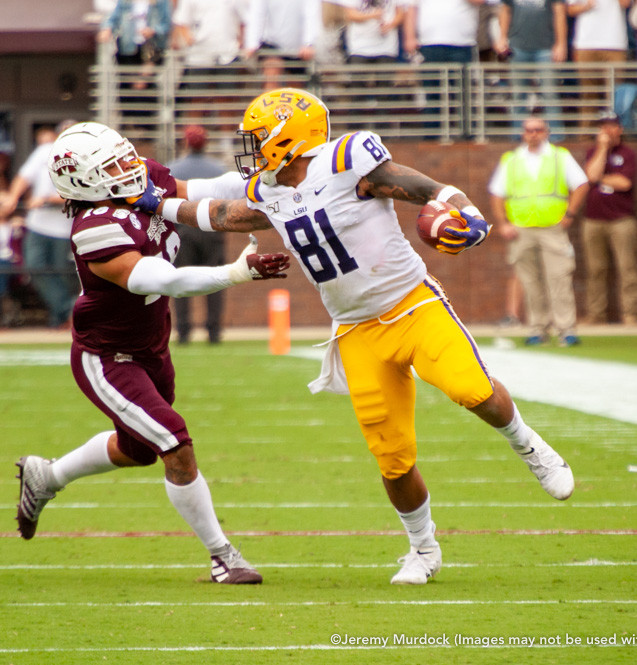 LSU star tight end Thaddeus Moss fights off a Bulldog defender.