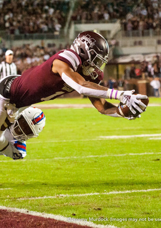 Stephen Guidry dives for a touchdown.