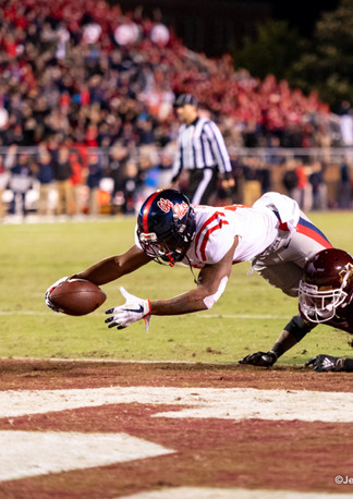 Ole Miss receiver Elijah Moore scores a touchdown late in the 2019 Egg Bowl.