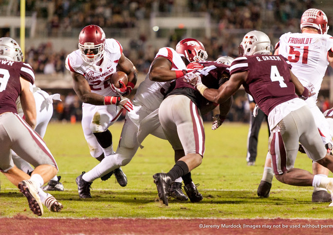 Arkansas running back attempts to break through the defensive line at the goal line.