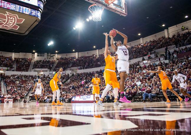 Star center Teaira McCowan takes a shot against a Tennessee defender.