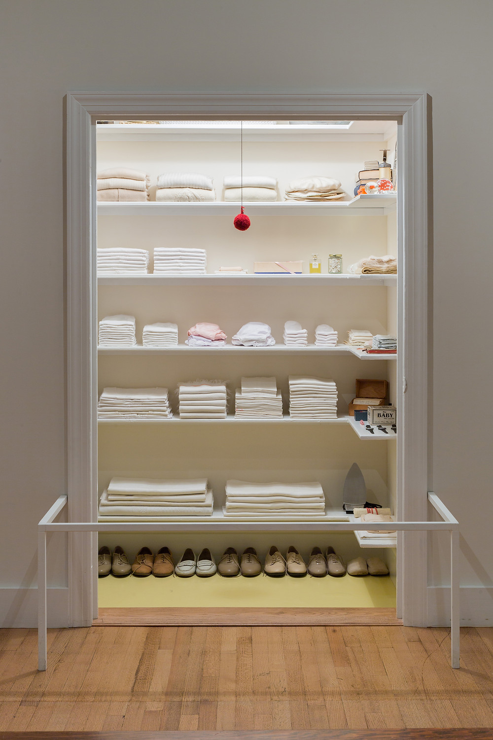 an art installation depicts an extremely organized closet