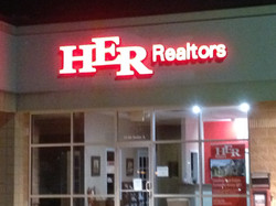 HER Realtors Sign
