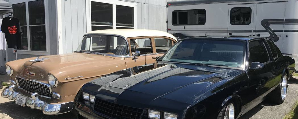 Two Chevys of more than 30 years' difference glisten in the Sunday sunshine.