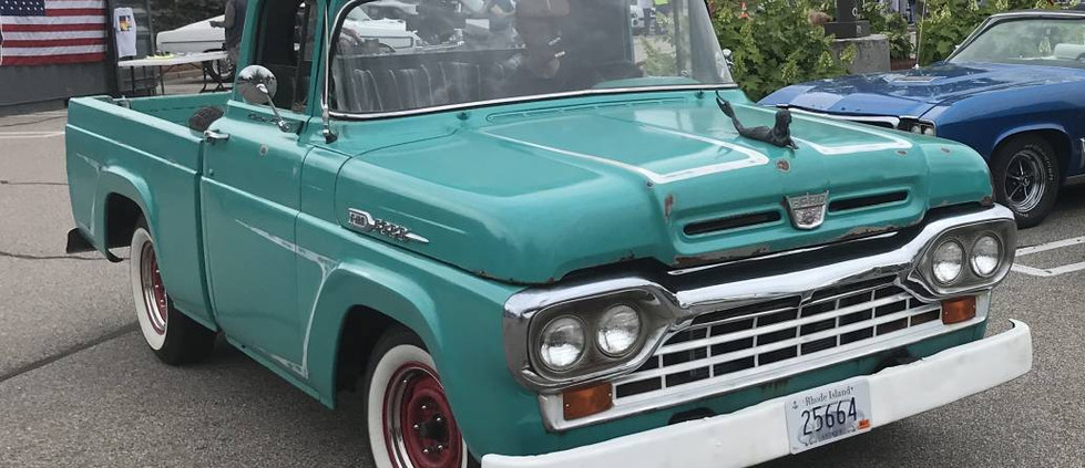Among several older F-Series pickups that joined the party was this sweet 1960.  Love the mermaid hood ornament.