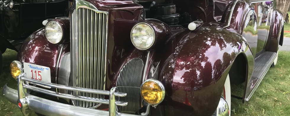 The imposing grille and front end work of a late 30s Packard.