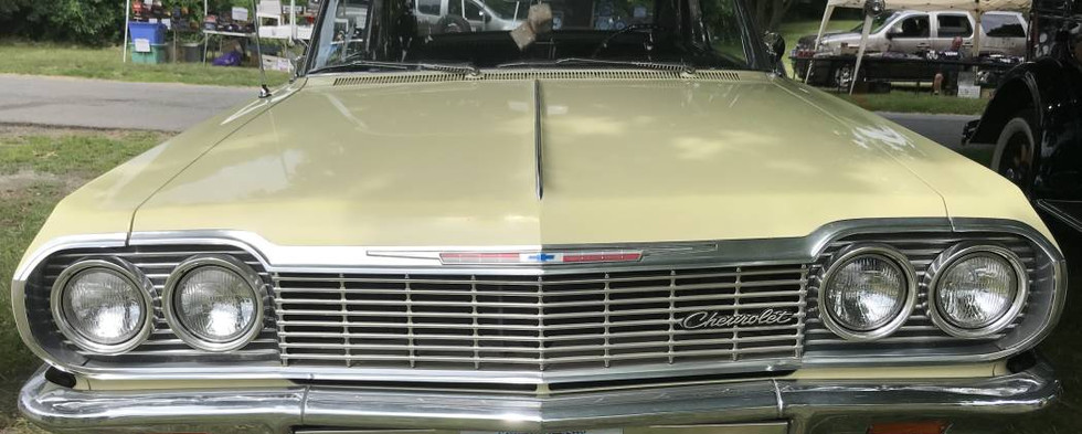 """Chevrolet's flagship for 1964...this Impala wore an unusual factory shade of """"Goldwood"""" yellow."""