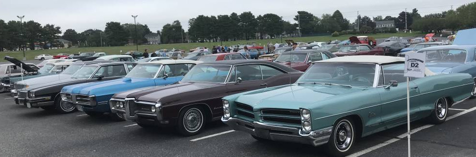 Clouds hung tough...but not a drop of rain fell in the evening...as an all-makes cruise kicked off a weekend for Pontiacs at the Crowne Plaza.