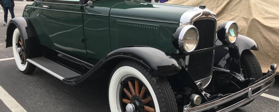 Oldest among the vehicles on display for the evening was this 1928 Pontiac landau.