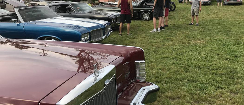 Looking across the long, crisp hood fo David S's 1978 Lincoln Town Car at so many other cool rides to see...