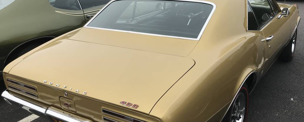 This golden little debut-model Firebird was basic & simple...another of the many Pontiacs that came up from Long Island.