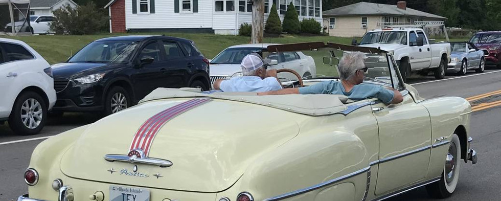 Lots of folks stopped at stared after this early 50s Pontiac convertible as it made a slow roll by on Rte 6.