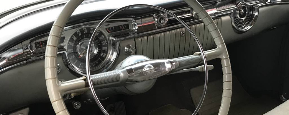 """Peeking inside Manny's 954 Oldsmobile...it won an award for the evening's """"top orphan."""""""