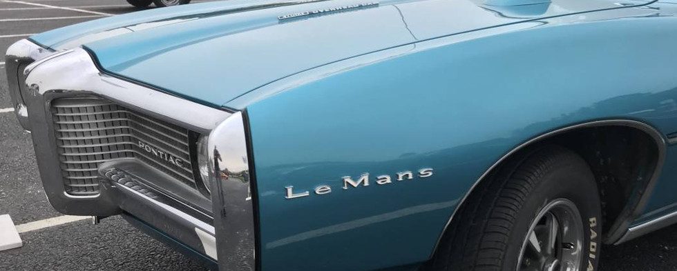 This Lemans was porting Pontiac's trademark hood-mounted tach.  Loved the color on this one.