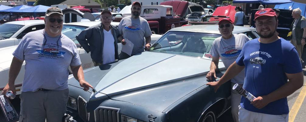 """Some of the """"Pontiac Posse,"""" posing with """"Mayor"""" Bobby's Grand Prix.  That's Marty on the far left, Tom, Frank, Steve & """"his honor"""" himself. moving clockwise."""