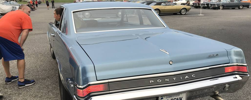 One of the many GTOs that made the scene pauses at the entry gate.