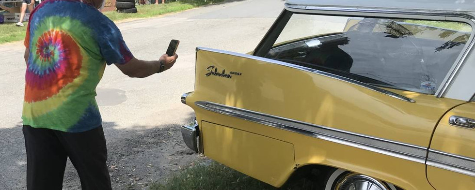 Ha ha...only a clown would pause to snap a shot of CruisinBruce's '59 Plymouth Sport Suburban wagon.