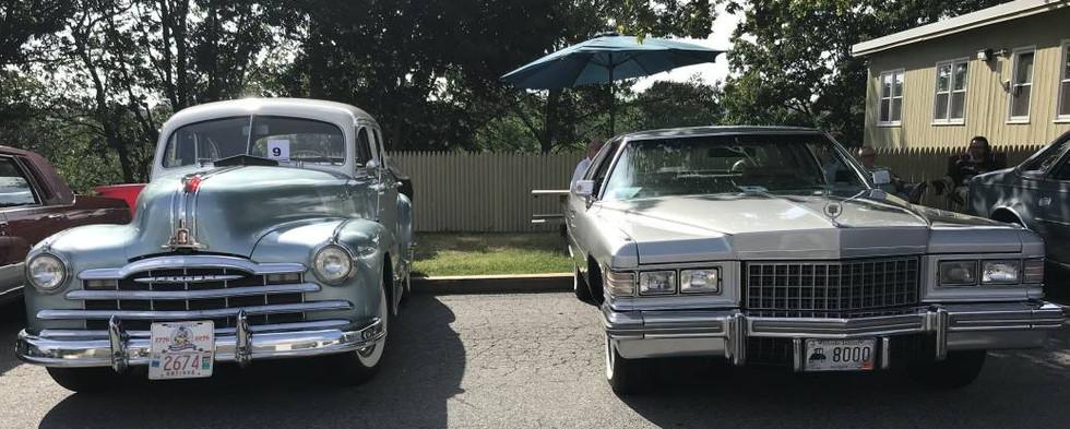 An interesting pairing of GM Products here finds a 1947 Pontiac settled in next to a 1976 Cadillac Coupe DeVille.
