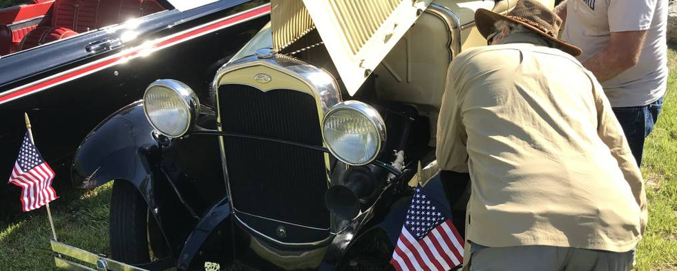Dwight F. took Phil S. for a little tour under the hood of his Model A Ford pickup.