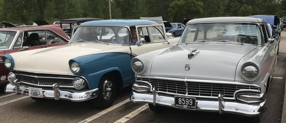 This pair of Ford sedans looked just right togehter.  That's a 1955 on the left in blue & white and a '56 next to it.