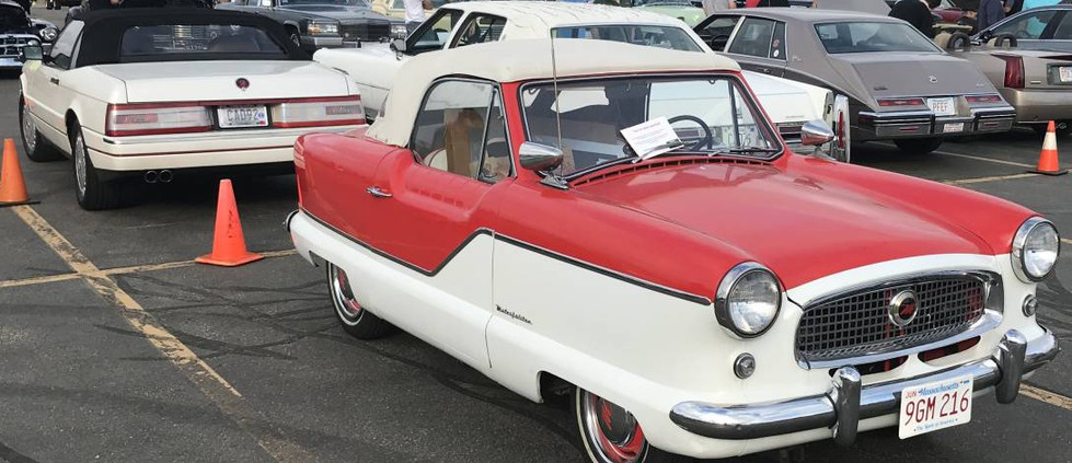 Hiding behind one of the Cadillac rows was this little Nash Metropolitan.  CHeck out the '92 Allante behind it.