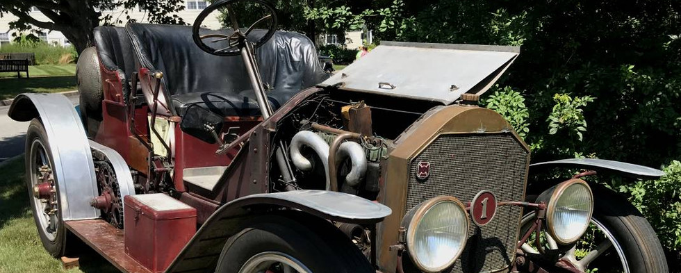 """The oldest car in the show field was awarded as """"Residents' Favorite.""""  It was the Kent family's 1917 American LaFrance Speedster."""