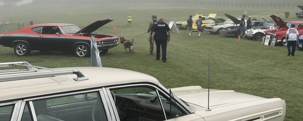 As Naval security strolled the grounds...even their K9 unit wanted to stop & check out the '69 Chevelle.