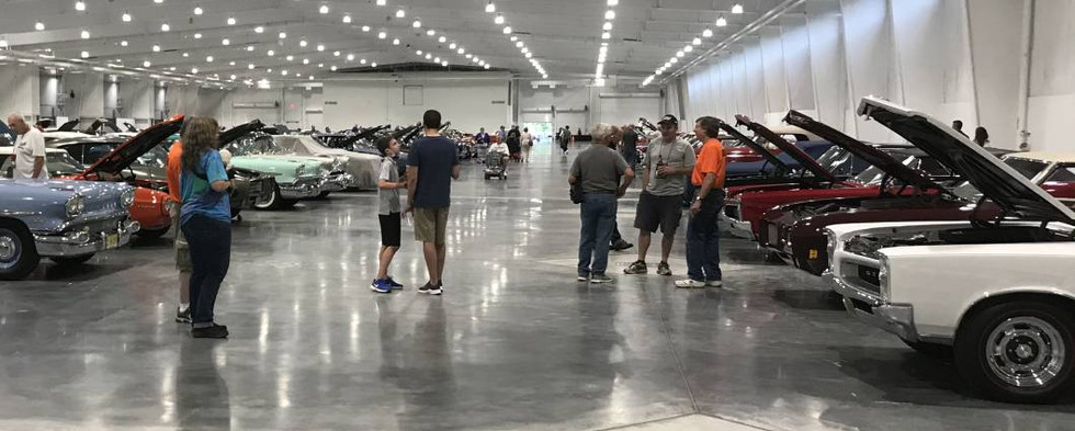The majority of cars inside are preparing for full 100-points judging, coming as the week progresses.