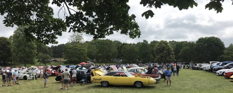 """Any wide shot of a car show scene which includes a """"wing car"""" (the yellow 1970 Plymouth Superbird at the head of the row) has got to be good."""
