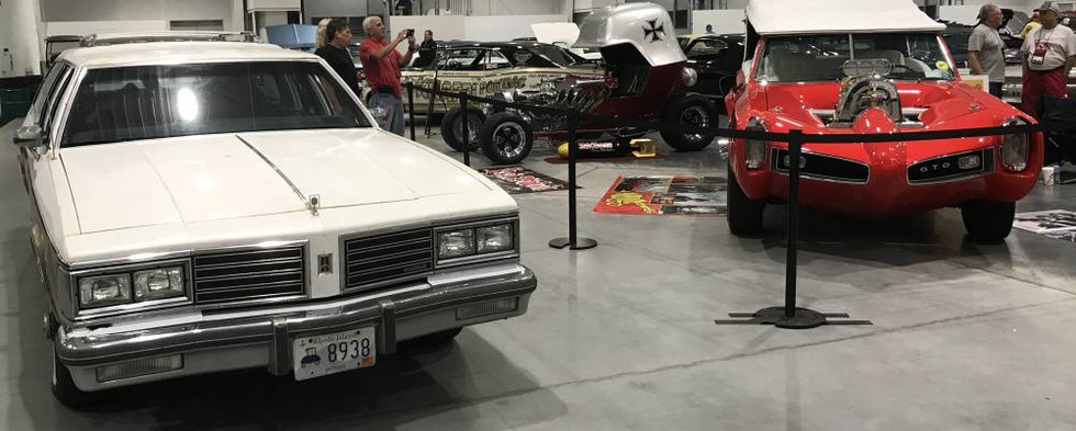 """Without a Pontiac currently in his stable, CruisinBruce brought his oldest GM...a 1985 Olds Custom Cruiser wagon...and he simply couldn't resist the temptation to grab a photo with its brethren wagon """"Monkeemobile."""" The fun continues all week long..."""