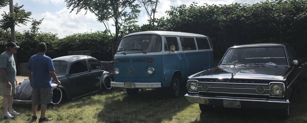 Ralph B's '66 Plymouth Belvedere shares space with a couple Volkswagens.