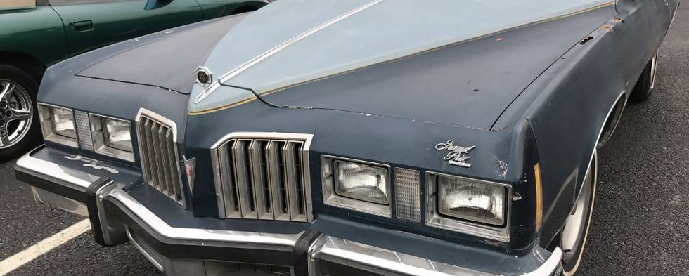 """By the mid-to-late 70s, Pontiac's Grand Prix reached its maximum girth.  This 1977 was among the premium """"personal luxury"""" cars of the year."""