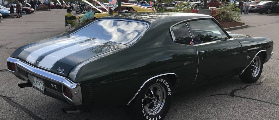 A 1970 Chevelle goes rumbling through the lot on a set of Keystone Classic Mags.