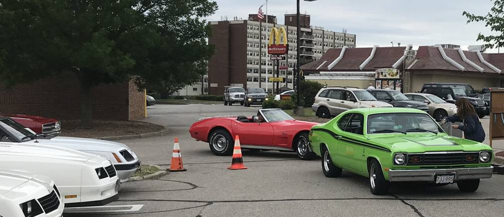 Bright colors were the order of the night...with this sublime green Duster followed by a bold red Corvette ragtop...and a close look will find a little '69 Dart GT headed in next.