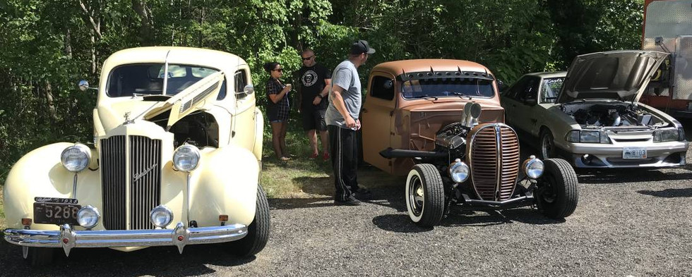 """From pure stock to classic customs, check out the """"Class of '38.""""  It's Phil R's 1938 Packard, next to a '38 Ford pickup street rod."""