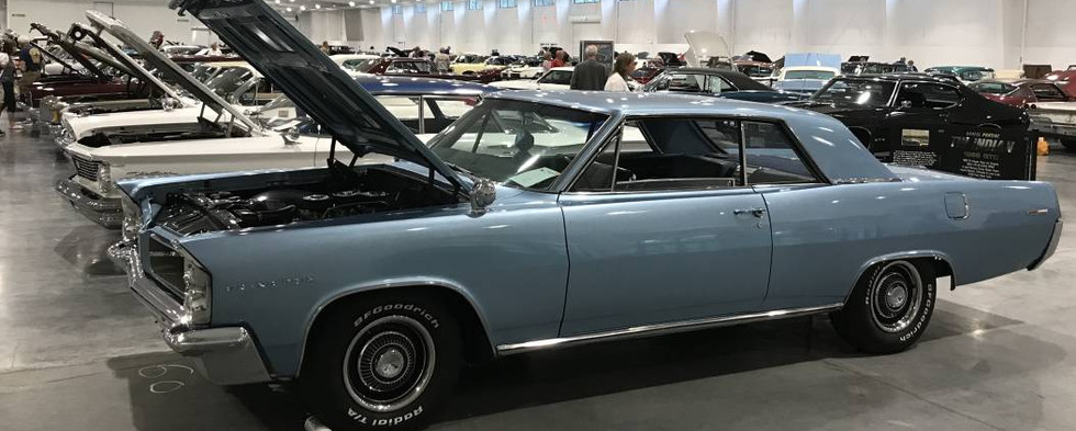Convention organizer Ron S. from Gardner, MA found a spot, right on the end, to show his 1963 Grand Prix hardtop.