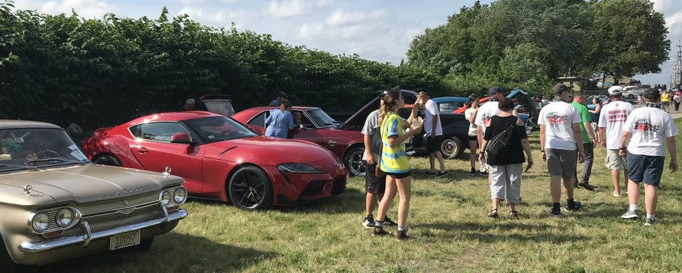 At the end of the street, the grassy field served well as an overflow lot for the nearly-100 cars that came out to enjoy the day.