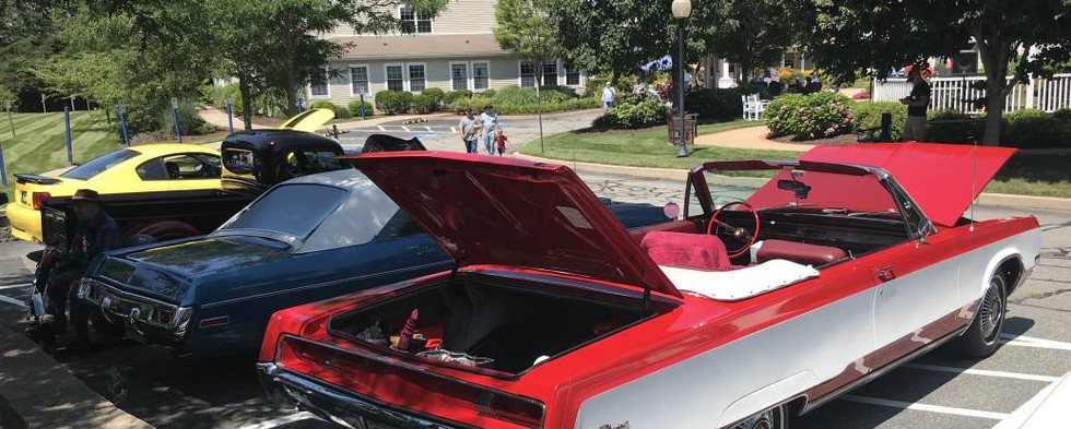 Reggie's 1968 Newport convertible and Danny's 1970 Dodge Dart Swinger next to it were a perfect matching red, white & blue set during Independence Day month.