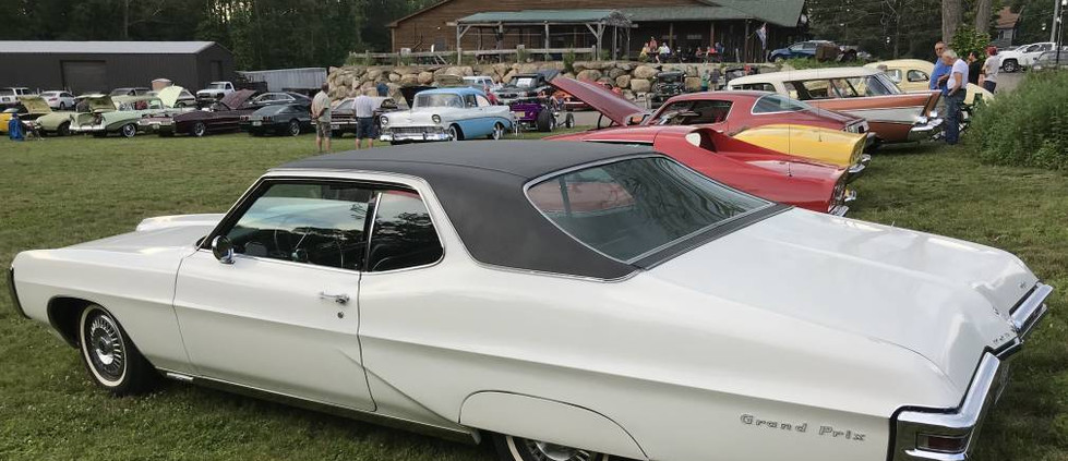 John R. loves the Wednesday night cruise...and can often be seen wheeling in with his '68 Pontiac Grand Prix.  That's it on the end.
