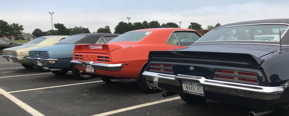 Quite a row of first generation Firebirds here.  Love the plate on that '69 on the near end...